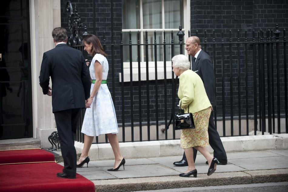 Britain's Queen Elizabeth and Prince Philip follow Prime Minister David Cameron and his wife Samantha as they arrive for a lunch at number 10 Downing Street in London