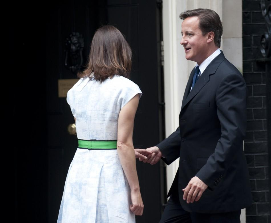 Britain's Prime Minister David Cameron and his wife Samantha return to number 10 Downing Street after waving off Queen Elizabeth and Prince Philip in London