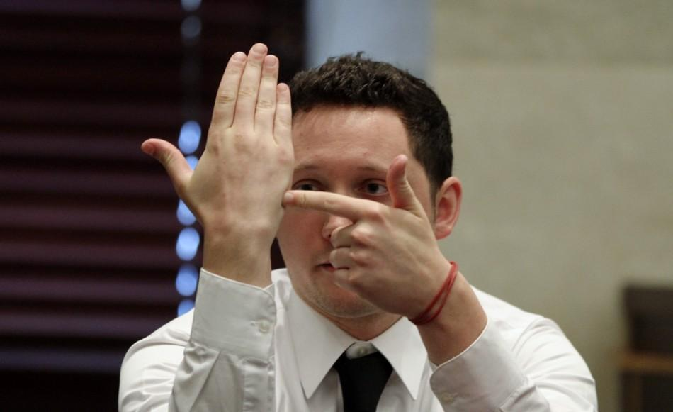 Tony Lazzaro uses hand gestures to explain his position relative to a car during testimony in Casey Anthony's first-degree murder trial in Orlando