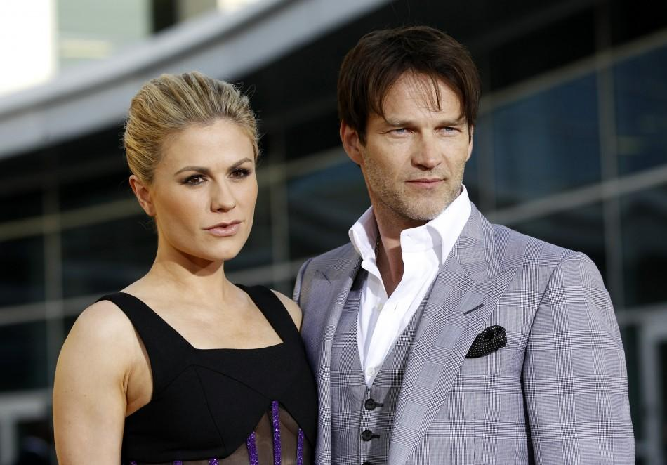 "Cast members Anna Paquin and her husband Stephen Moyer pose at the premiere for the fourth season of the HBO television series ""True Blood"" at the Cinerama Dome in Hollywood"