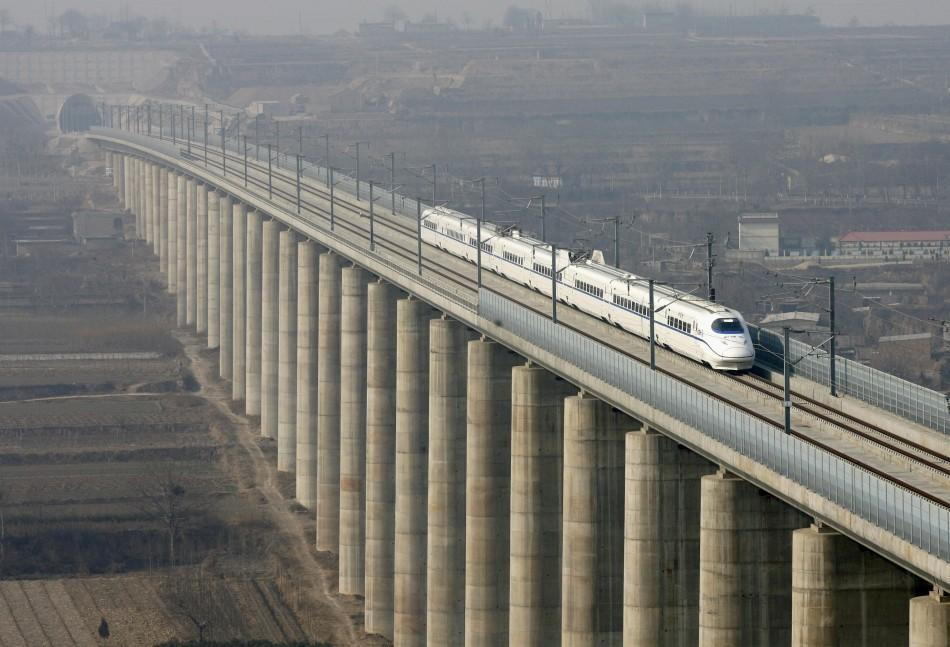A high-speed train travels on the newly built Zhengzhou-Xi'an railway in Zhengzhou.