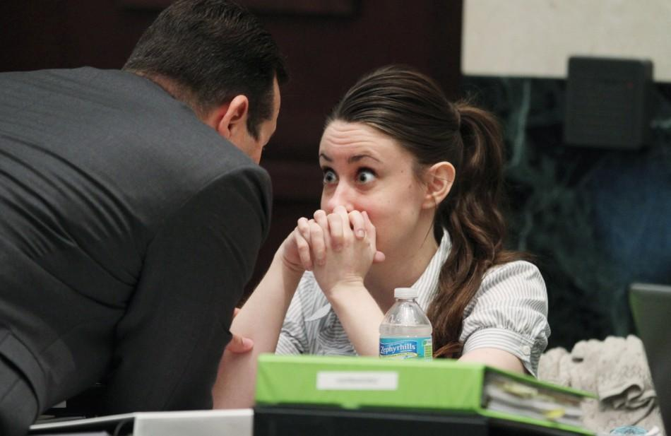 Casey Anthony talks with her attorney Jose Baez