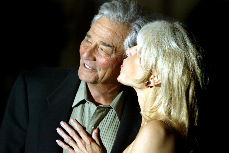 U.S.Actor Peter Falk is kissed by his wife Shera as they arrive for the David di Donatello film awards in Rome April 14, 2004.