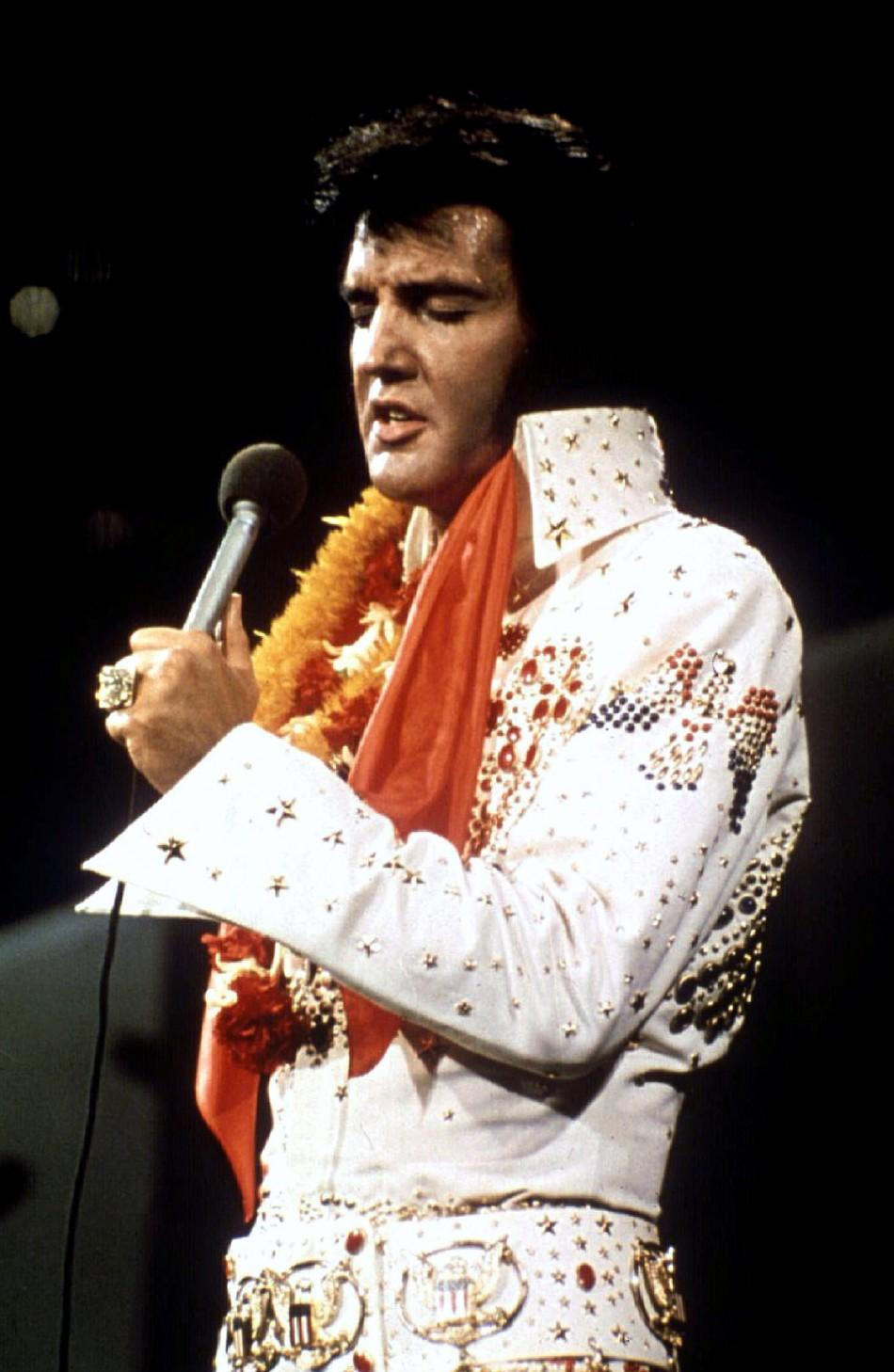 """FILE PHOTO 1972 - Elvis Presley performs in concert during his """"Aloha From Hawaii"""" 1972 television s.."""