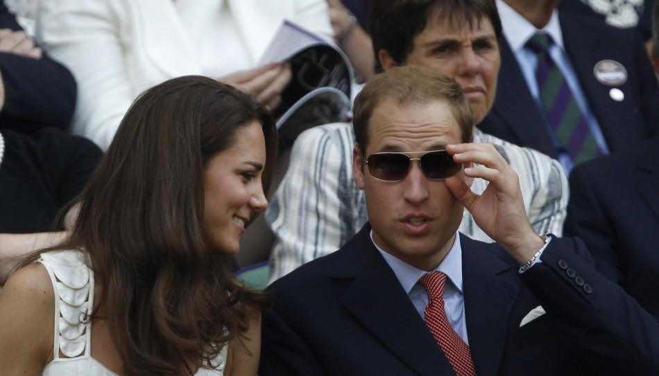 Britain's Catherine, Duchess of Cambridge sits with Her Husband Prince William