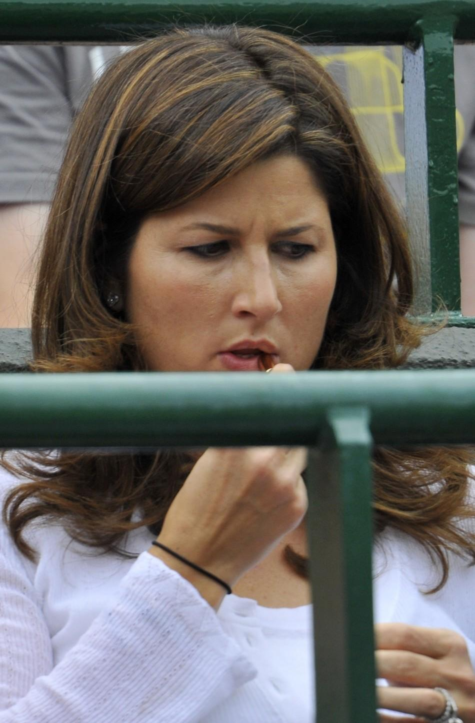 The wife of Roger Federer of Switzerland, Mirka Federer, sits on Court 1 for Federer's match against Mikhail Youzhny of Russia at the Wimbledon tennis championships in London