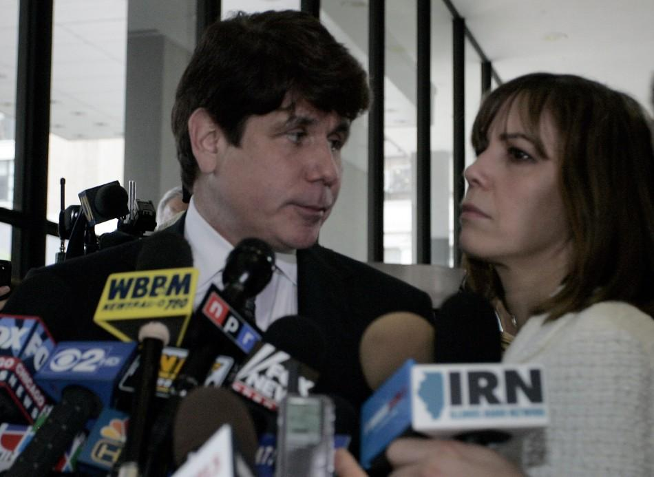 Former Illinois Governor Rod Blagojevich looks at his wife Patti before they leave the Dirksen Federal building after being convicted on 17 of 20 counts in his second corruption trial in Chicago