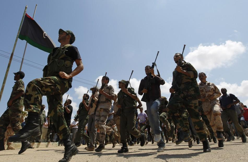 Rebel fighters march during their graduation ceremony in Benghazi