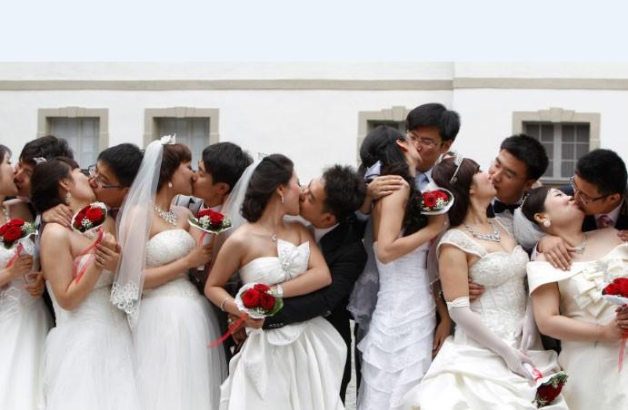 Chinese bridal couples kiss after their symbolic wedding in Fuessen June 3, 2011