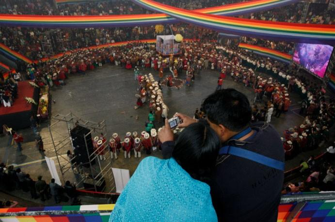 A couple takes pictures during an indigenous mass wedding ceremony in La Paz, May 7, 2011