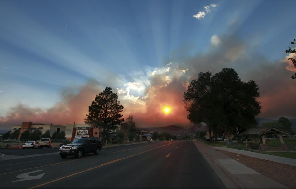 Sun shines through the smoke from the Las Conchas wildfire in Los Alamos