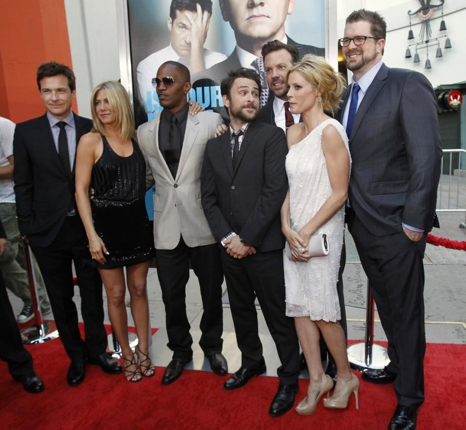 "Director of the movie Seth Gordon (R) poses with cast members (from L-R) Jason Bateman, Jennifer Aniston, Jamie Foxx, Charlie Day, Jason Sudeikis and Julie Bowen at the premiere of ""Horrible Bosses"" at the Grauman's Chinese theatre in Holly"