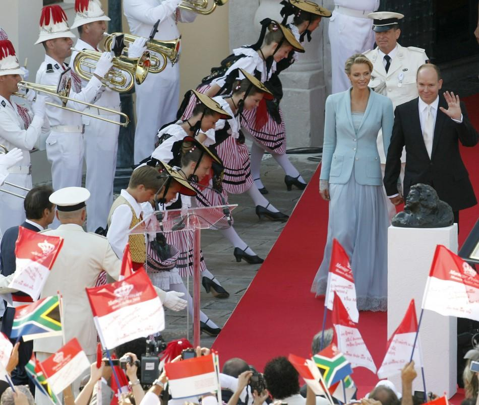 Newlyweds Prince Albert II of Monaco and Princess Charlene arrive on the Palace square after their civil wedding service in Monaco