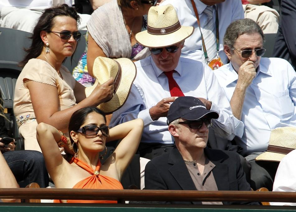 Businessman Pinault and actress Hayek attend the semi-final match between Nadal of Spain and Murray of Britain during the French Open tennis tournament at the Roland Garros stadium in Paris
