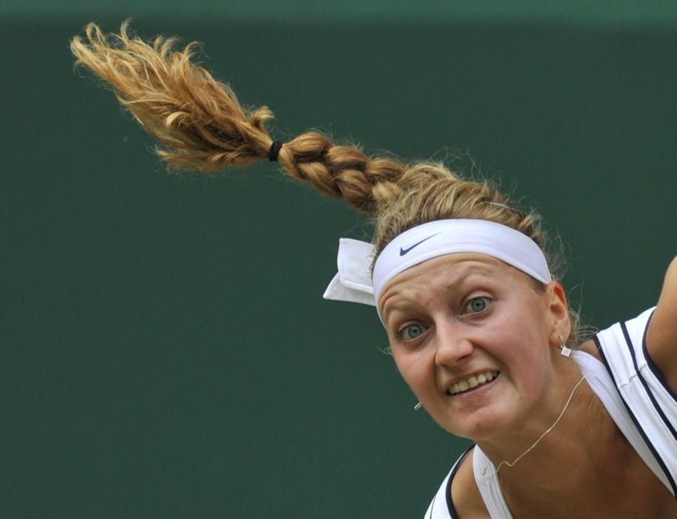 Petra Kvitova of the Czech Republic serves to Maria Sharapova of Russia during their final match at the Wimbledon tennis championships in London