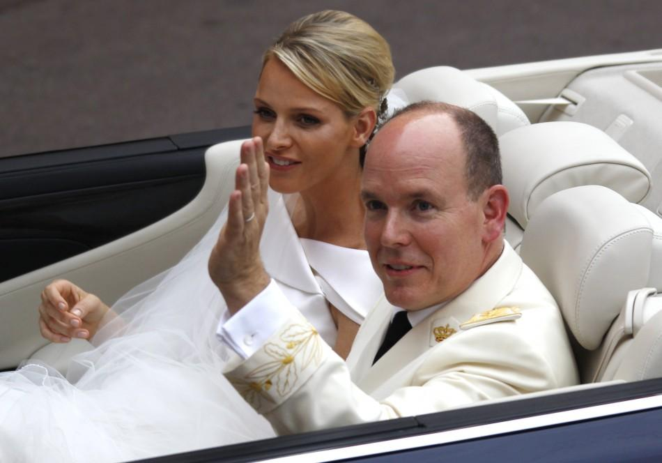 Monaco's Prince Albert II and Princess Charlene leave the Palace after the religious ceremony in Monaco