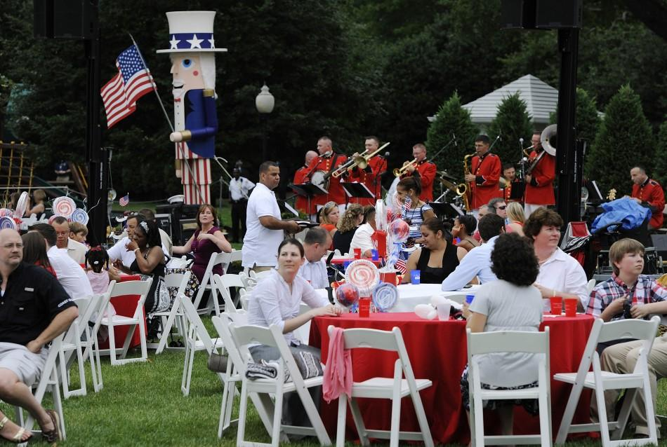 Families of U.S. servicemen and women attend an Independence Day barbeque at the White House in Washington