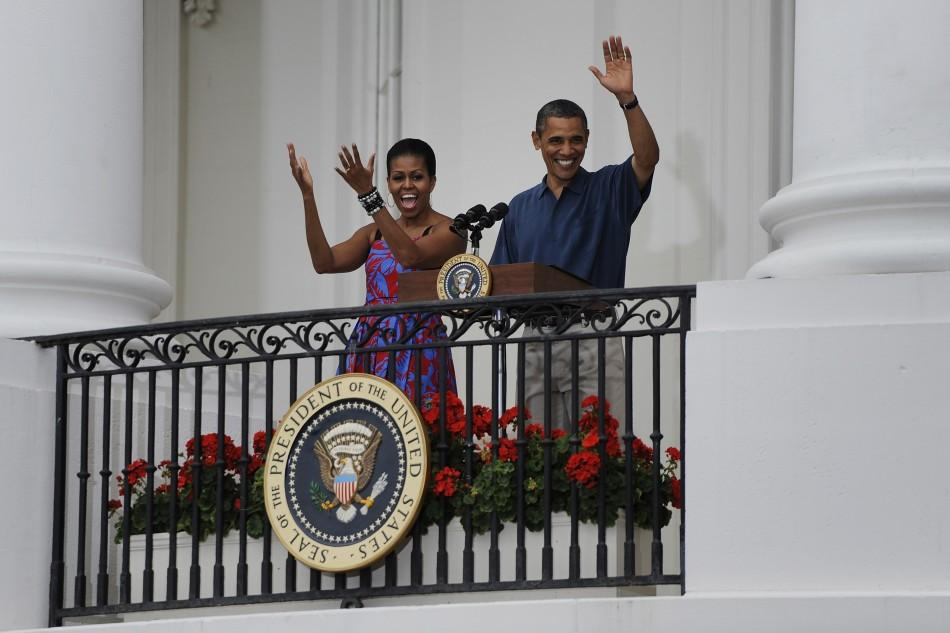 U.S. President Barack Obama and his wife Michelle arrive to make remarks at an Independence Day barbeque at the White House in Washington