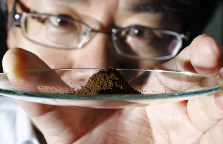 Kato, an associate professor of earth science at the University of Tokyo, displays a mud sample extracted from the depths of about 4,000 metres (13,123 ft) below the Pacific ocean surface in Tokyo