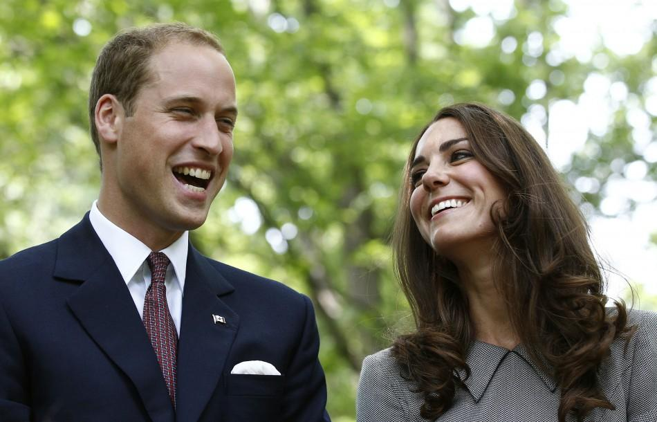 Britain's Prince William and his wife Catherine, Duchess of Cambridge, laugh during a tree planting ceremony at Rideau Hall in Ottawa July 2, 2011.