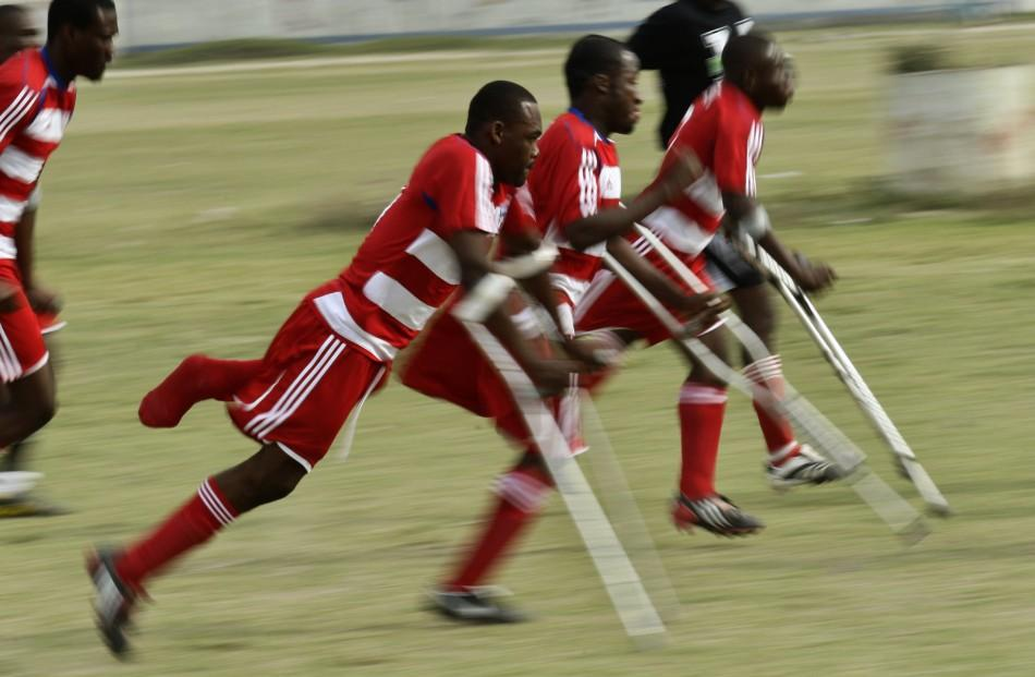 Haitian soccer players of the national amputee team warm up before a friendly match against Zaryen team in Port-au-Prince