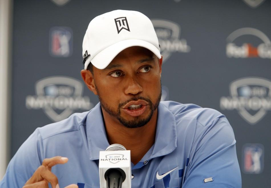 Tiger Woods answers questions during a news conference before the start of the AT&T National golf tournament at the Aronimink Golf course