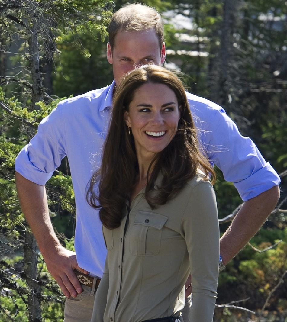 Britain's Prince William and his wife Catherine listen to members of the Canadian Rangers while visiting Blatchford Lake