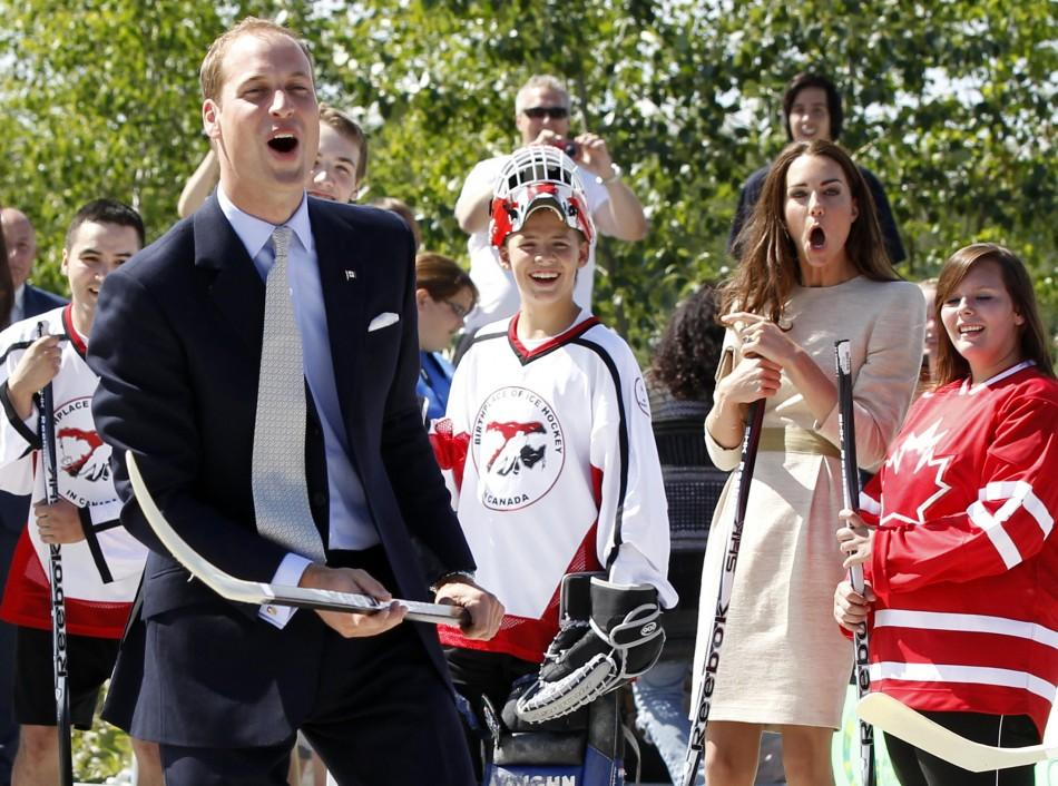 Britain's Prince William and his wife Catherine, the Duchess of Cambridge, react during visit to Somba K'e Civic Plaza in Yellowknife