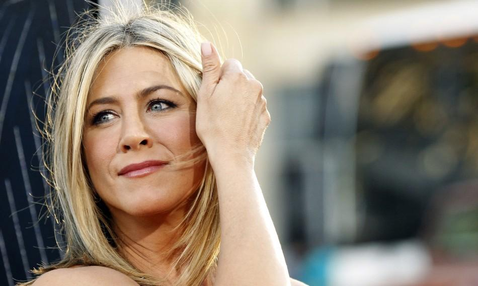 "Cast member Jennifer Aniston poses at the premiere of ""Horrible Bosses"" at the Grauman's Chinese theatre in Hollywood, California June 30, 2011. Aniston made $28 million last year."