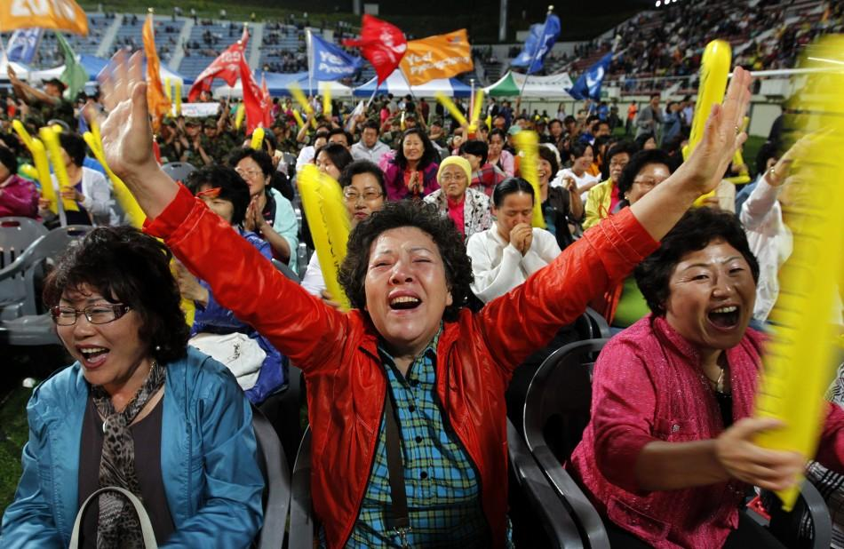 South Koreans react as they hear that Pyeongchang would win in a first round of voting