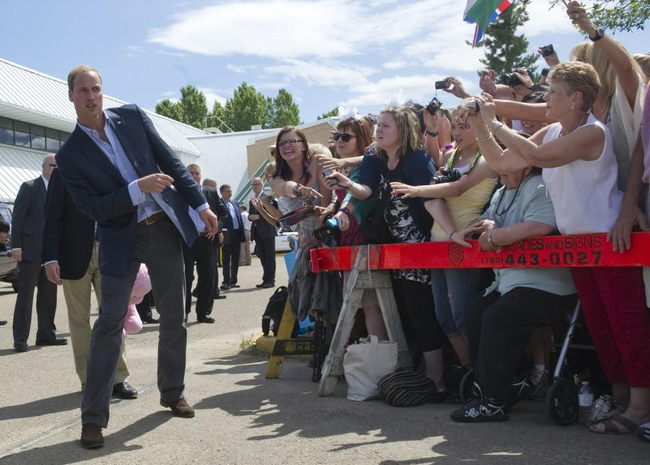 Britain's Prince William looks down the line of the gathered crowd during a visit to Slave Lake, Alberta