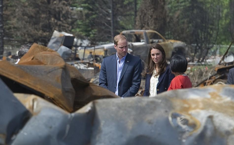 Britain's Prince William and his wife Catherine, Duchess of Cambridge, talk with Mayor Pillay-Kinnee as they visit a fire-devastated town in Slave Lake, Alberta