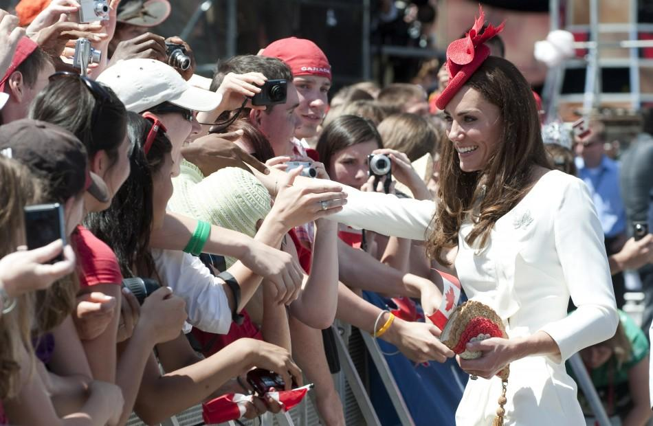 Catherine, Duchess of Cambridge, greets spectators during Canada Day celebrations on Parliament Hill in Ottawa