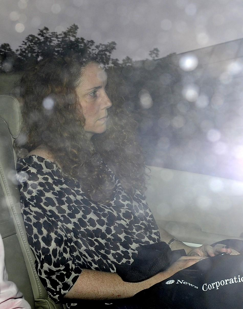 Rebekah Brooks, Chief Executive of News International, leaves her office in Wapping