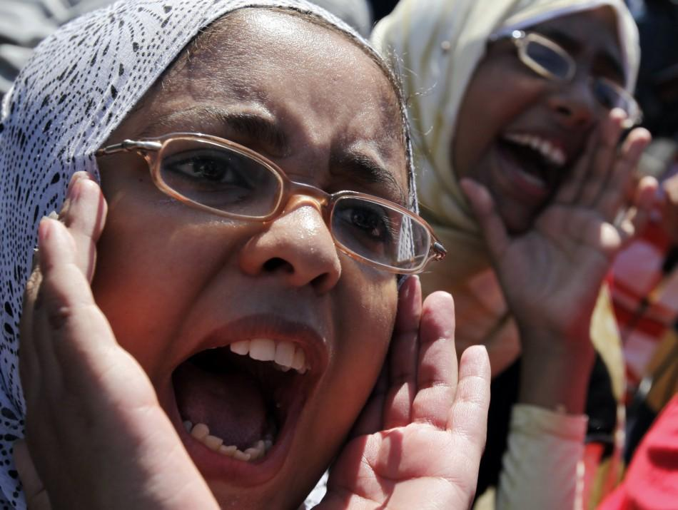 Demonstraters chant slogans against police outside court building during trial of two police officers in Alexandria