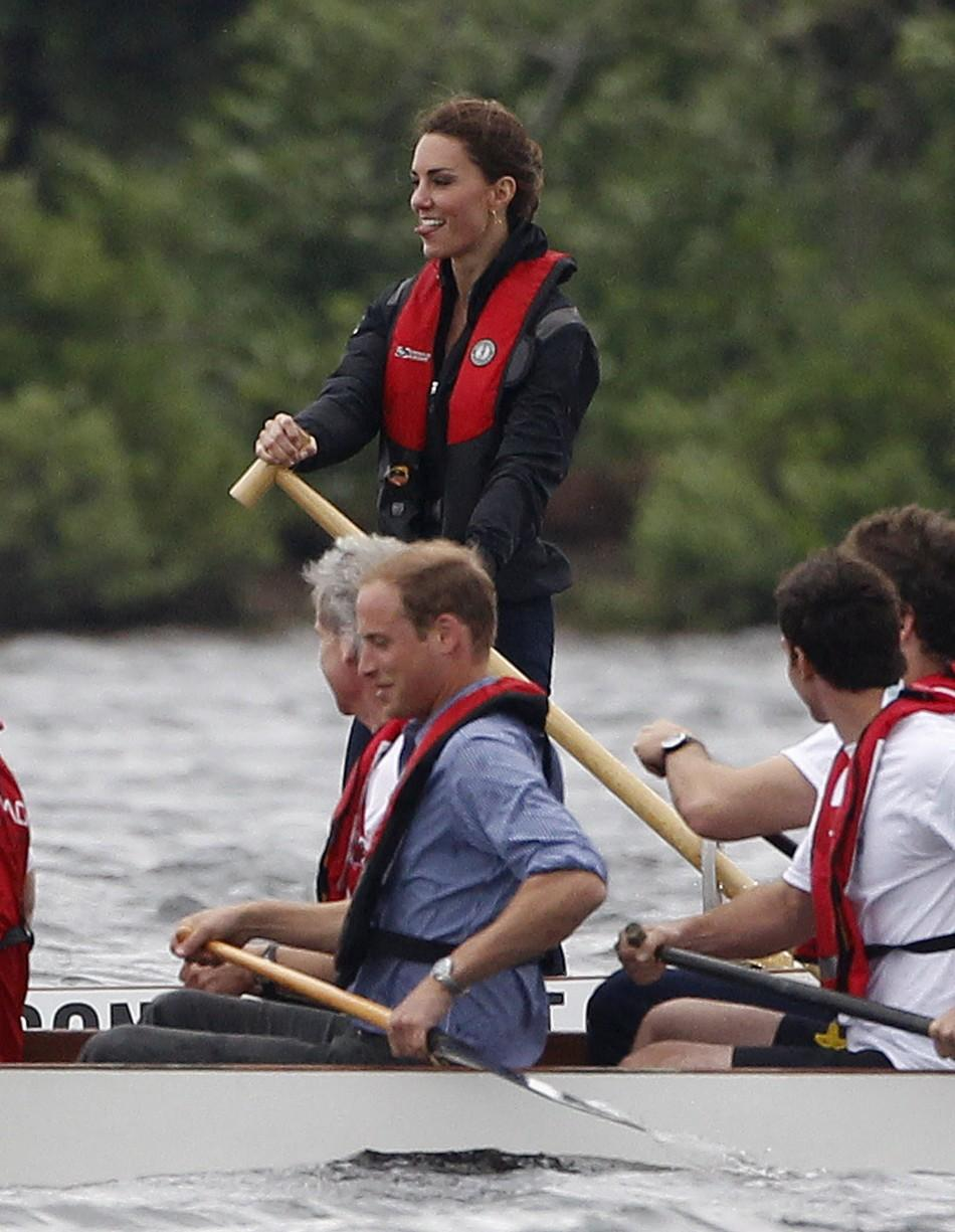 Britain's Prince William and his wife Catherine, Duchess of Cambridge, compete in a dragon boat race in Dalvay-by-the-sea