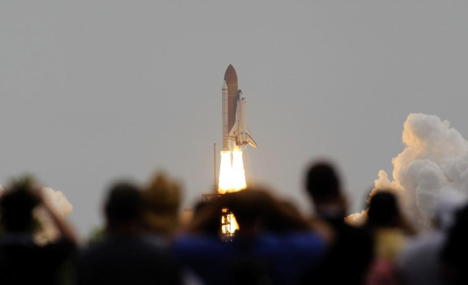 The space shuttle Atlantis, STS-135 lifts off from launch pad 39A at the Kennedy Space Center in Cape Canaveral, Florida