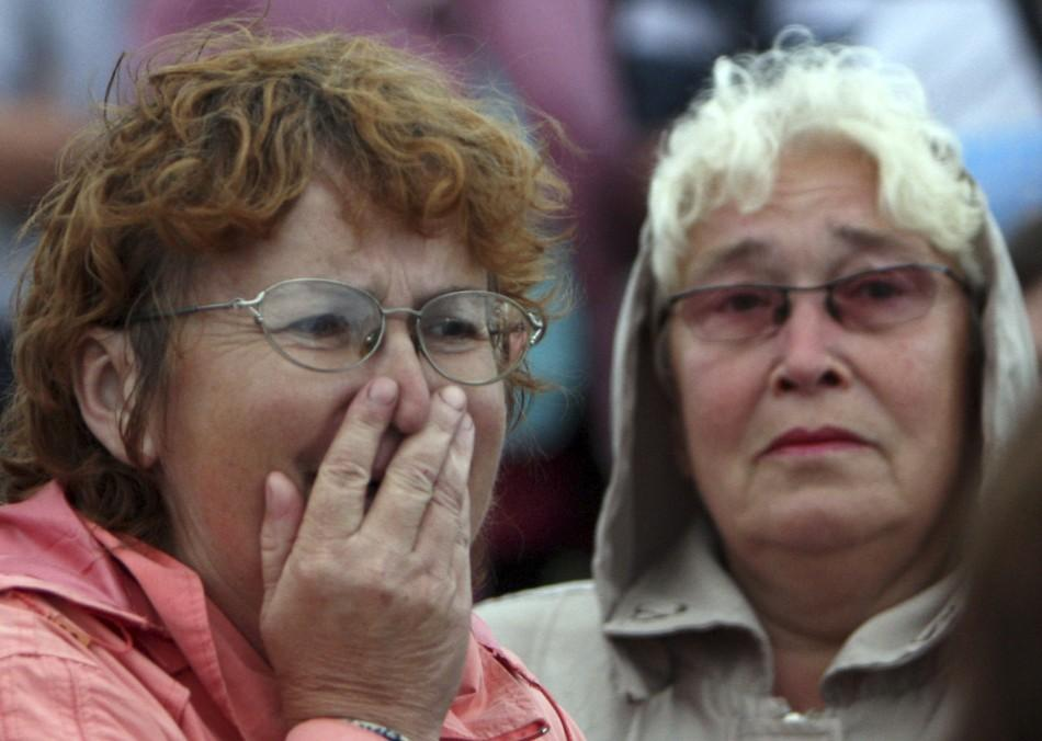 A woman reacts as she meets survivors from the Bulgaria tourist boat, which sank on the Volga river, at the port of Kazan