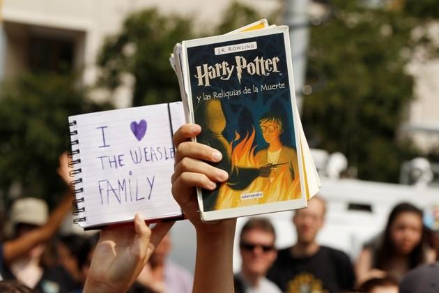 "Harry Potter fans hold up mementos at the premiere of the film ""Harry Potter and the Deathly Hallows: Part 2"" in New York"