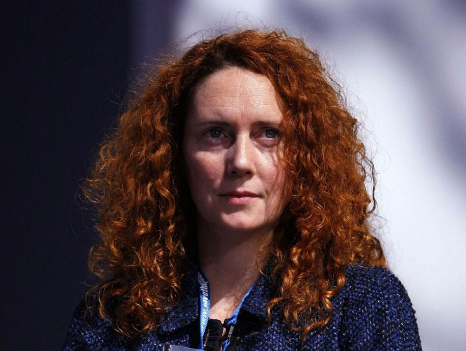 Chief Executive of News International, Rebekah Brooks, listens to speeches