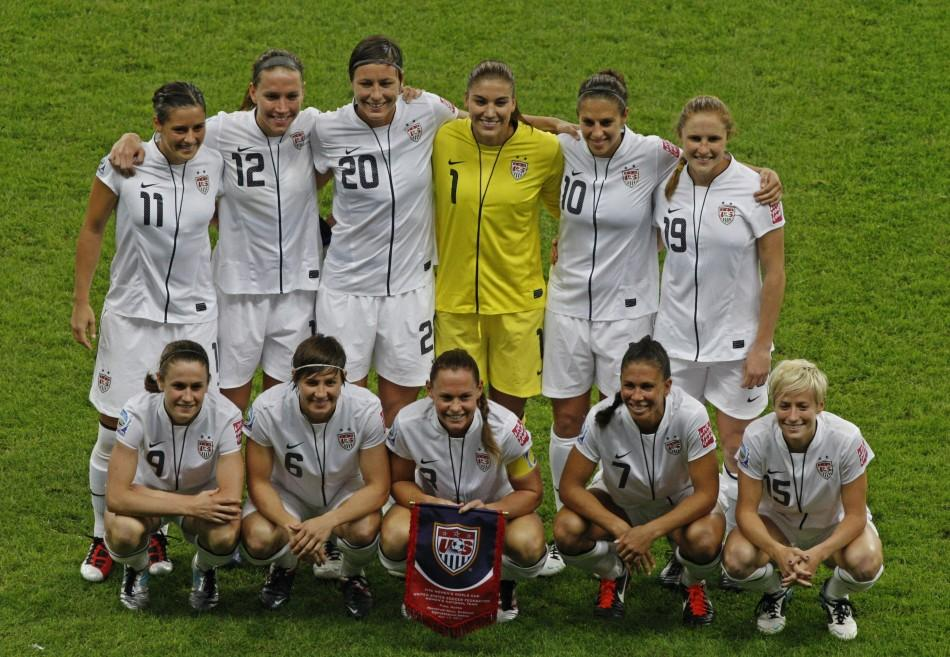Members of the U.S. team pose for photographers before the start of their Women's World Cup final soccer match against Japan in Frankfurt