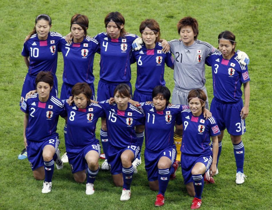 Members of Japan's team pose for photographers before the start of their Women's World Cup final soccer match against the U.S. in Frankfurt