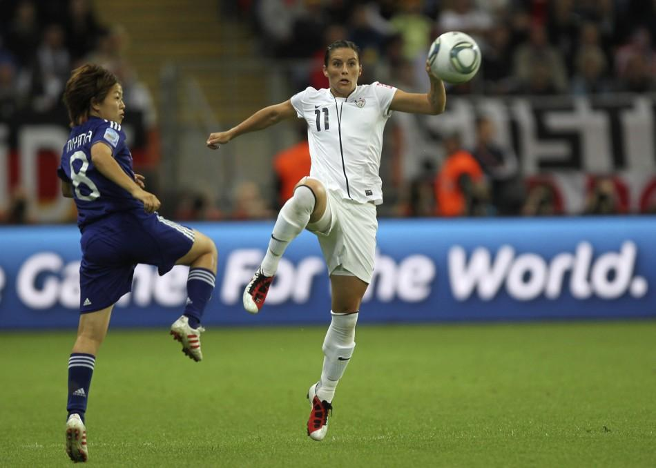 Aya Miyama (L) of Japan challenges Alex Krieger of the U.S. during their Women's World Cup final soccer match in Frankfurt