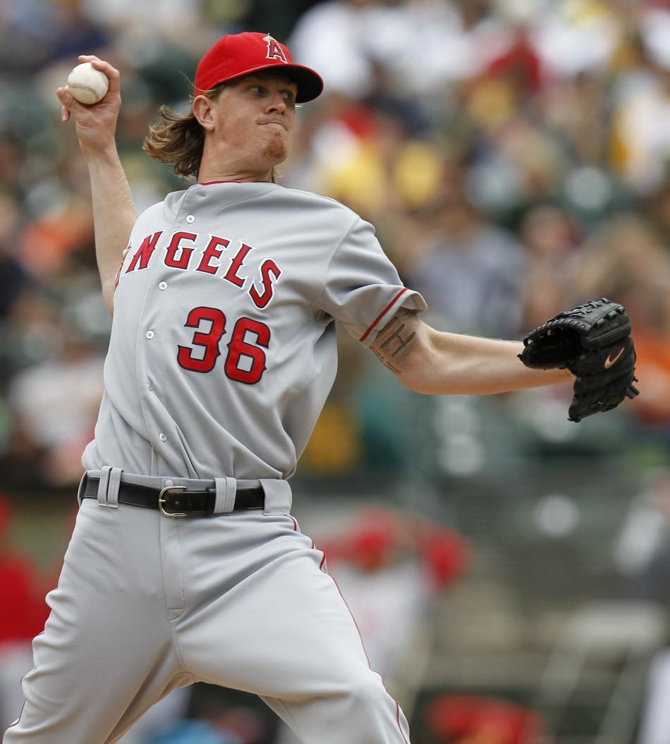 Los Angeles Angels starting pitcher Jered Weaver throws in the first inning against the Oakland Athletics during the first game of their MLB American League baseball game doubleheader in Oakland, California