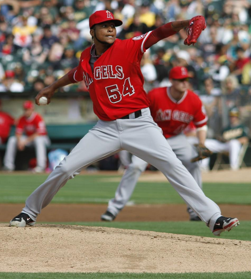 Los Angeles Angels starting pitcher Ervin Santana throws in the first inning against the Oakland Athletics during the second game of their MLB American League baseball doubleheader in Oakland, California