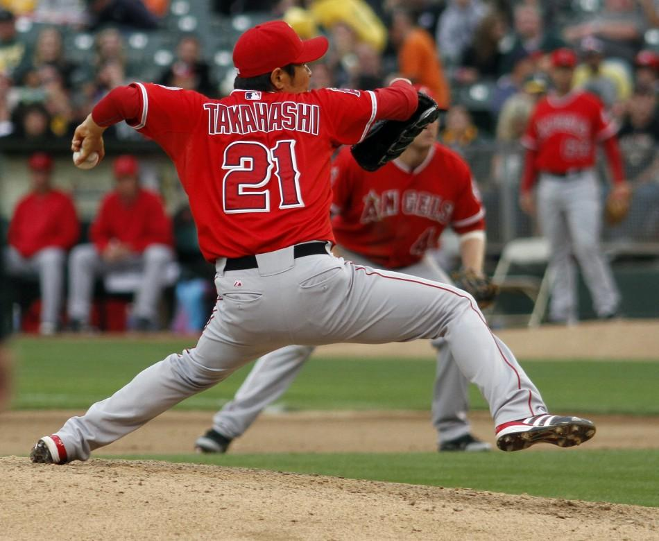 Los Angeles Angels relief pitcher Hisanori Takahashi throws in the eighth inning against the Oakland Athletics during the second game of their MLB American League baseball doubleheader in Oakland, California