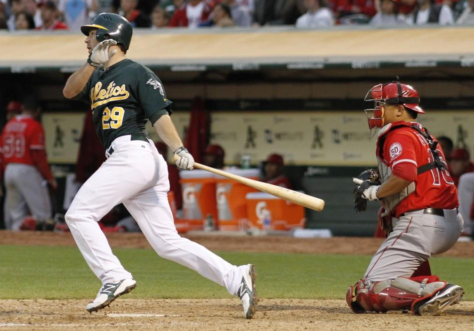 Oakland Athletics Scott Sizemore hits a game-winning RBI single in the 10th inning against the Los Angeles Angels during the second game of their MLB American League baseball doubleheader in Oakland, California
