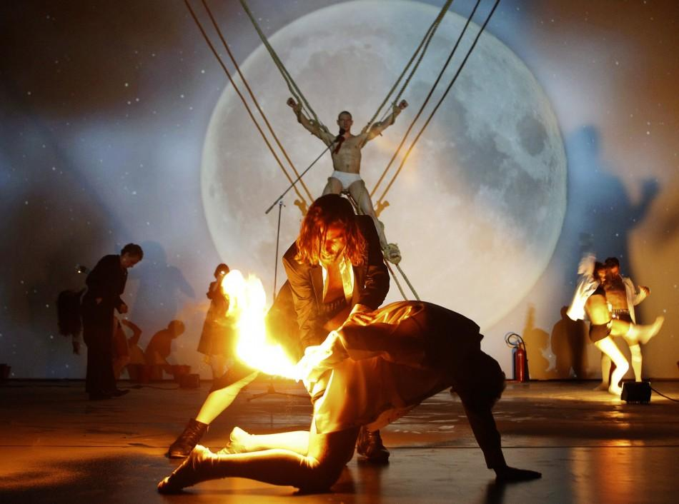 Dancers perform on stage during a dress rehearsal of Troubelyn/Jan Fabre dance company's performance 'PROMETHEUS - Landscape II' at Volkstheater in Vienna