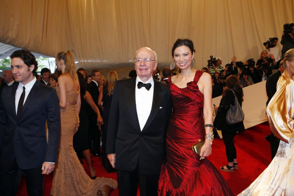 News Corp CEO Murdoch and his wife Deng Murdoch pose on red carpet at Metropolitan Museum of Art Costume Institute Benefit in New York