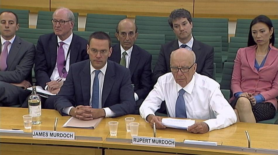News Corp Chief Executive and Chairman Rupert Murdoch sits without his jacket after being attacked with a plate of white foam, during a parliamentary committee hearing at Portcullis House in London